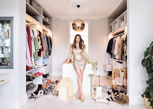 Wow:In another image taken in her wardrobe she posed in a short gold dress and shiny heels which showed off her toned legs