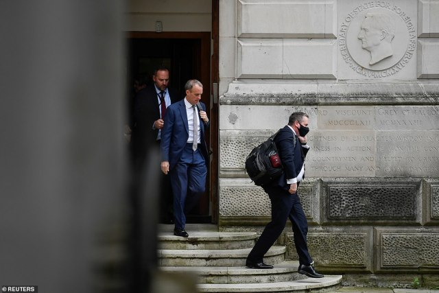 A pensive-looking Dominic Raab was spotted leaving the Foreign Office with bags and heading for the House of Commons this afternoon
