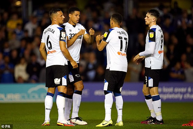 Derby players Curtis Davies (second left) and Ravel Morrison (second right) have both spoken highly of Rooney's coaching