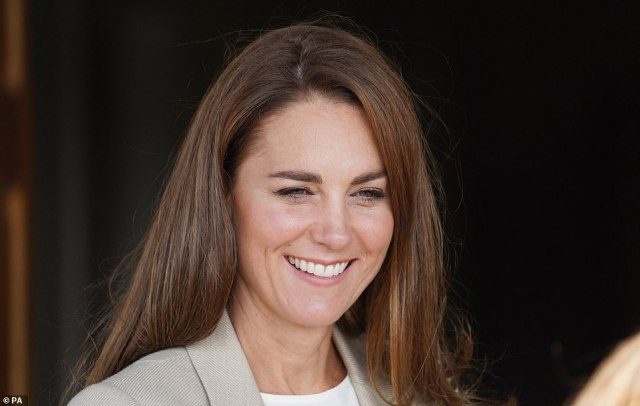 The Duchess of Cambridge smiles a visit to RAF Brize Norton to meet military personnel who helped evacuate Afghans