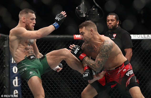 McGregor is currently recovering from a grizzly leg break suffered after Dustin Poirier (right)