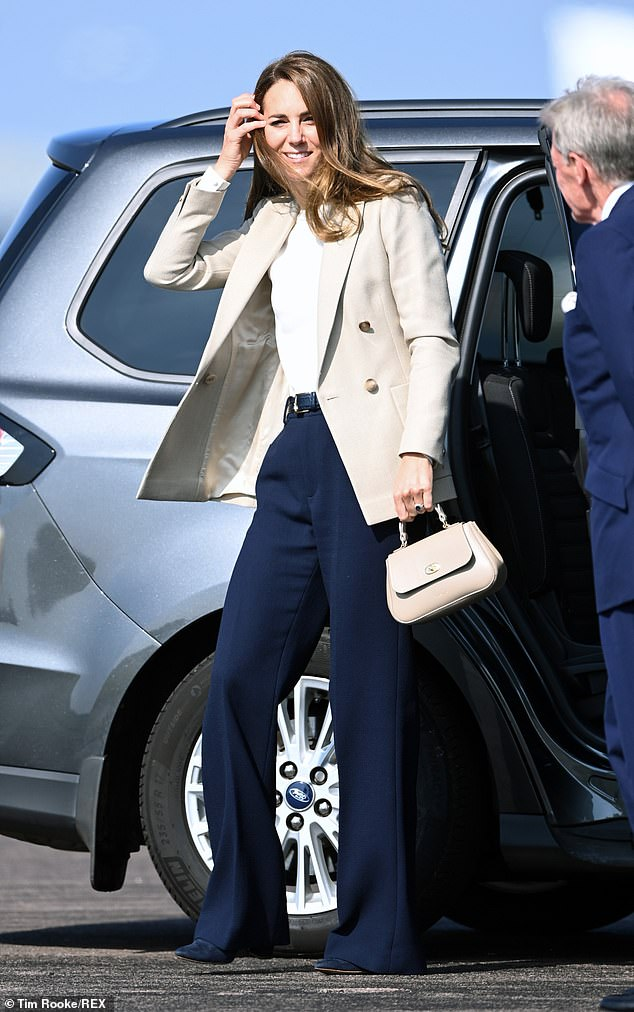Kate Middleton (pictured) looked the picture of elegance in a white, round neck t-shirt and neutral-coloured £285 Reiss double breasted blazer