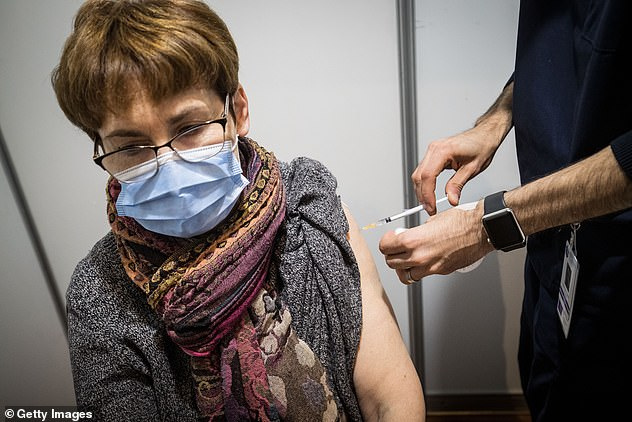 The message from the Australian Medical Association, and from the federal government is 'do not wait'. Pictured: A woman receives the AstraZeneca dose in Melbourne