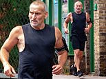 Doctor PHEW! Muscular Christopher Eccleston, 57, enjoys a jog ahead of his return to Doctor Who