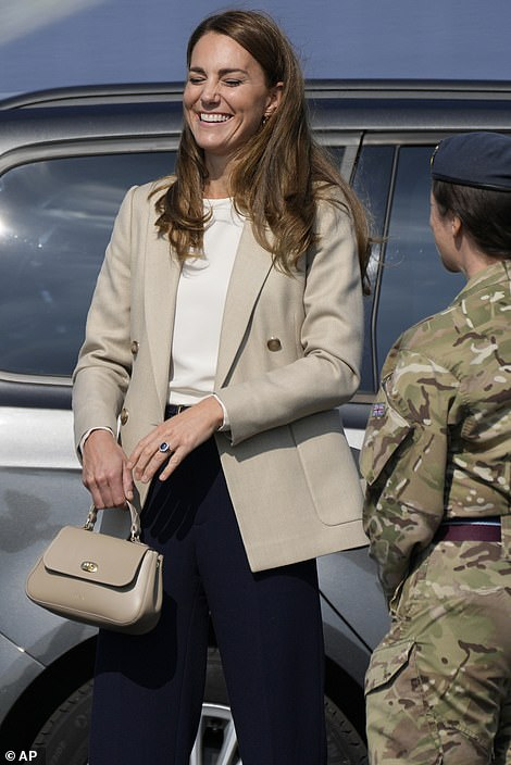 The Duchess of Cambridge laughs as she speaks to military personnel