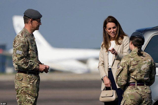 Kate meets military personnel as she arrives for a visit to RAF Brize Norton in Oxfordshire this afternoon