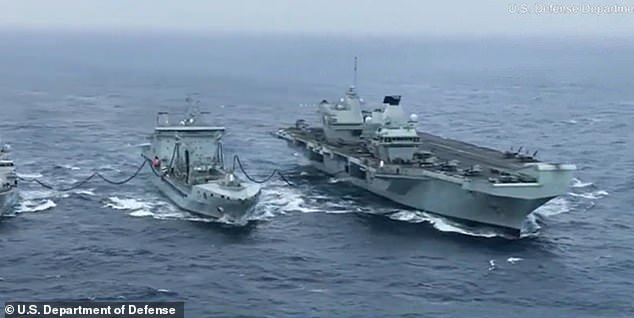 US Marines with Marine Fighter Attack Squadron 211 flying F-35B Lightning II's conduct routine operations aboard HMS Queen Elizabeth while she conducts a double replenishment with RFA Tidespring and HNLMS Evertsen in the South China Sea on 29 July, 2021