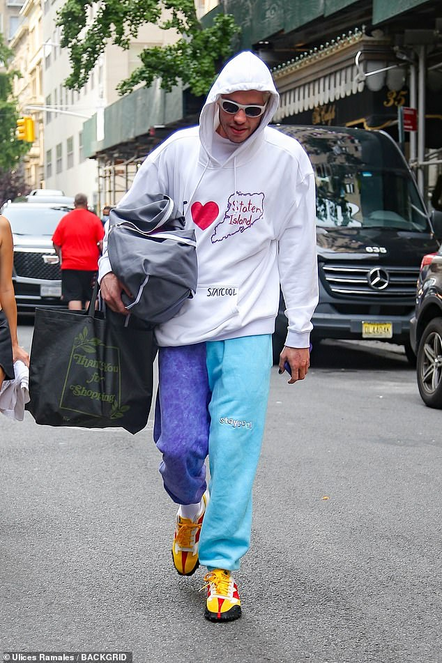 Coordination: The Meet Cute star paired his sweatshirt with two-tone blue sweatpants that were also from the clothing line
