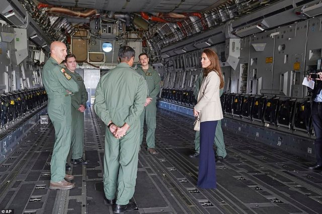 The Duchess of Cambridge stands in the fuselage of an RAF C17 Globemaster during her visit to RAF Brize Norton today