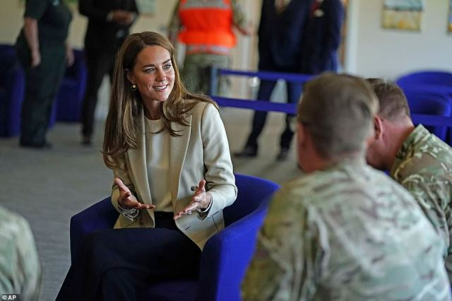 The Duchess of Cambridge speaks to members of the armed forces at RAF Brize Norton in Oxfordshire this afternoon