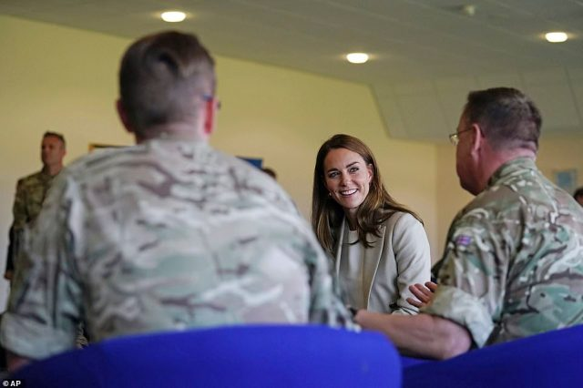 The Duchess of Cambridge speaks to members of the armed forces while visiting RAF Brize Norton this afternoon