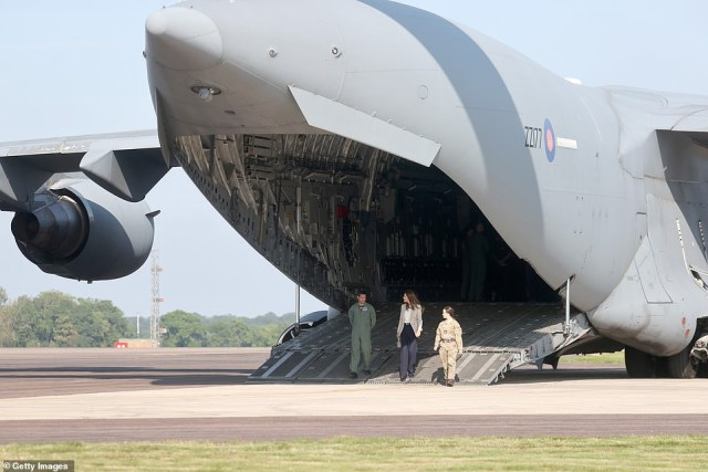 The Duchess of Cambridge walks off a C17 transporter today as she speaks to those who supported the evacuation effort