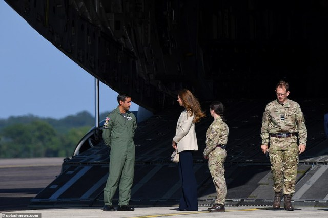 The Duchess of Cambridge speaks to armed forces personnel under an RAF C17 Globemaster at Brize Norton today