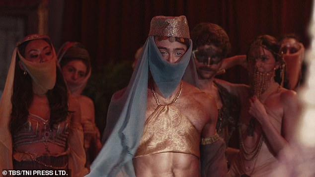 Transformation: Daniel Radcliffe looked to worlds far from his Hogwarts days as he dressed as an exotic dancer for a scene from his new show Miracle Workers: Oregon Trail