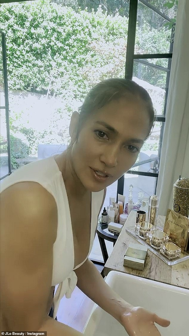 Jennifer Lopez says she 'NEVER leaves the house without lip gloss and mascara'