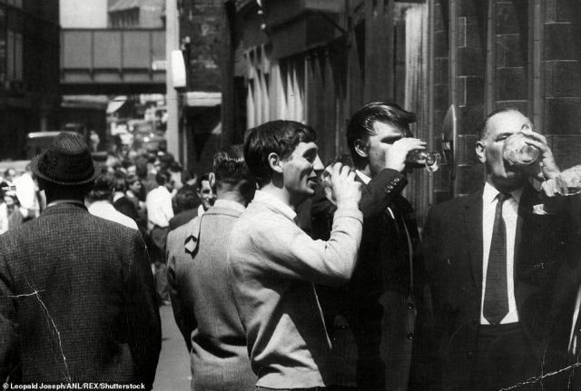 Unofficial strikers are seen drinking near Truman's Brewery at a pub on Brick Lane in 1966