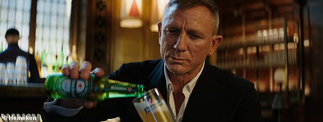Patience is a virtue: Daniel Craig, 53, poked fun at the Covid delays of James Bond film No Time To Die as he paused to take a sip of his lager in a new Heineken advert called Worth The Wait