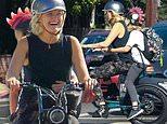 Malin Akerman beams as she drives her son Sebastian home from school on her electric bike