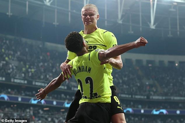 Erling Haaland celebrates with Bellingham after scoring the second goal for Dortmund