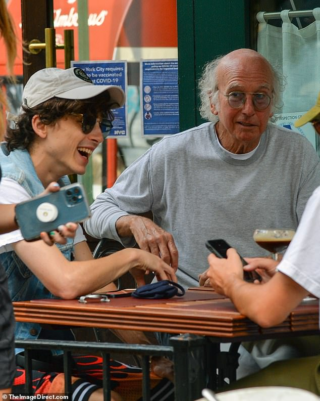 Odd couple: Curb Your Enthusiasm creator Larry David (R) enjoyed drinks al fresco with Timothée Chalamet (L) at Sant Ambroeus in Manhattan on Monday