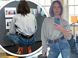 Victoria Beckham elongates her lithe legs with scarlet heels at her fashion brand's office