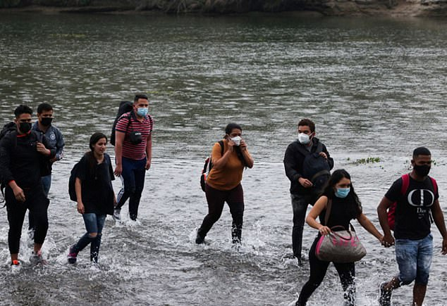 Anyone crossing the border has had the option to get vaccinated since early August, but it is on a voluntary basis and migrants will still not need the shot or proof of vaccination toenter the country. Above, migrants are seen crossing the Rio Grande river