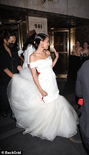 Before the gala, AOC got ready at The Carlyle hotel on the Upper East Side. She was escorted to a chauffer-driven car, with someone carrying the train of her dress, and she waved to screaming fans as she left the hotel
