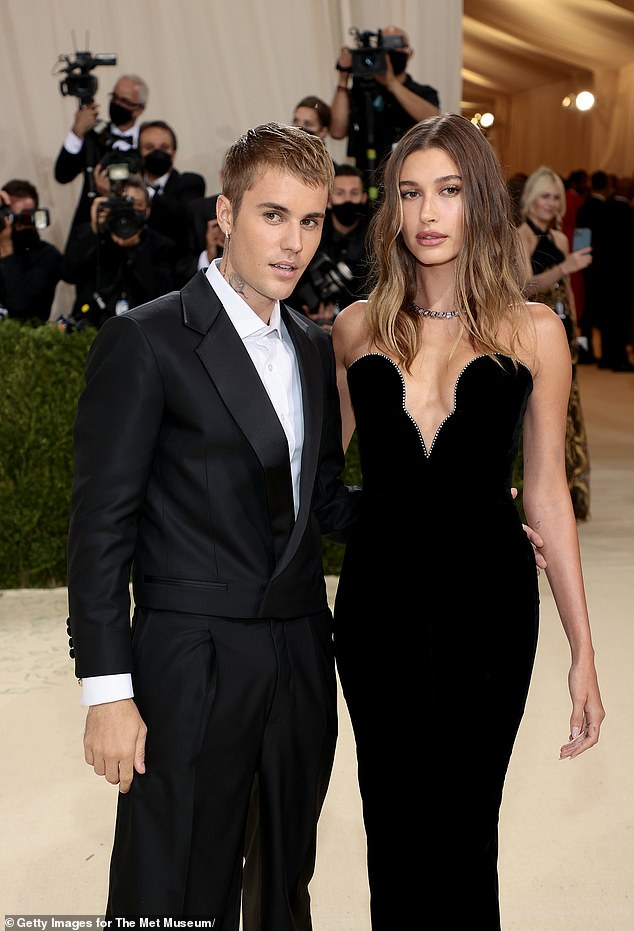 Striking:Hailey donned a sleek black strapless Saint Laurent gown featuring crystals along her bustline with Tiffany & Co. jewels