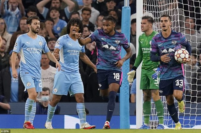 Nkunku (third left) sealed his hat-trick by crashing in a low effort to make it 4-3 and notch the pressure back on City