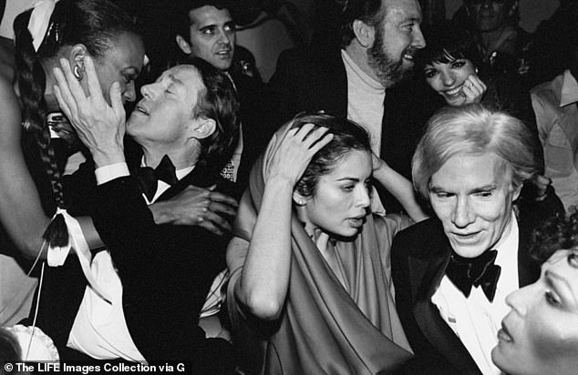 Jagger was one of the biggest style icons of the 1970s and a fixture at the legendary nightclub Studio 54. Pictured L-R: Halston, Jagger, Jack Haley, Liza Minnelli and Andy Warhol celebrate New Year's Eve at Studio 54