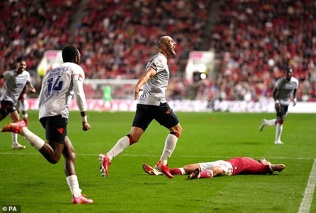 Danny Hylton (centre) salvaged a point for Luton Town against Bristol with a last-gasp strike