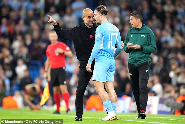 Grealish (middle) was still reprimanded by Pep Guardiola (left) over his defensive work rate