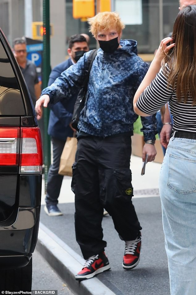 Taking it easy: Ed wore an indigo Louis Vuitton zip-up hoodie with black cargo pants and red-and-white Nikes