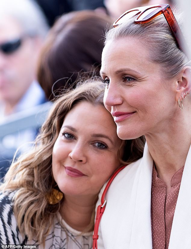 Au natural:Both ladies have spoken about the topic of plastic surgery in the past, openly with Diaz saying she regretted getting botox and Barrymore saying she has 'never done anything' to her face; pictured 2019