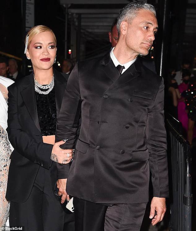It sure looks like true love: Rita and her boyfriend Taika Waititi were being tactile as they headed to the event