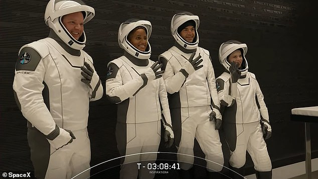 Four members of the Inspiration 4 mission donned SpaceX's iconic white suits as they prepared for their journey to become the first all-civilian crew in space.