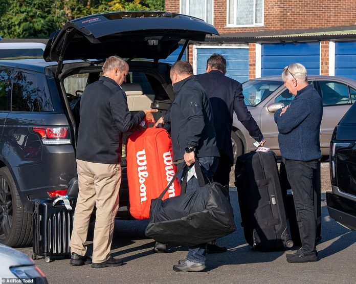 US Open Winner Emma Raducanu arrives back at the family home this morning with her bags - including her tennis equipment - carried in