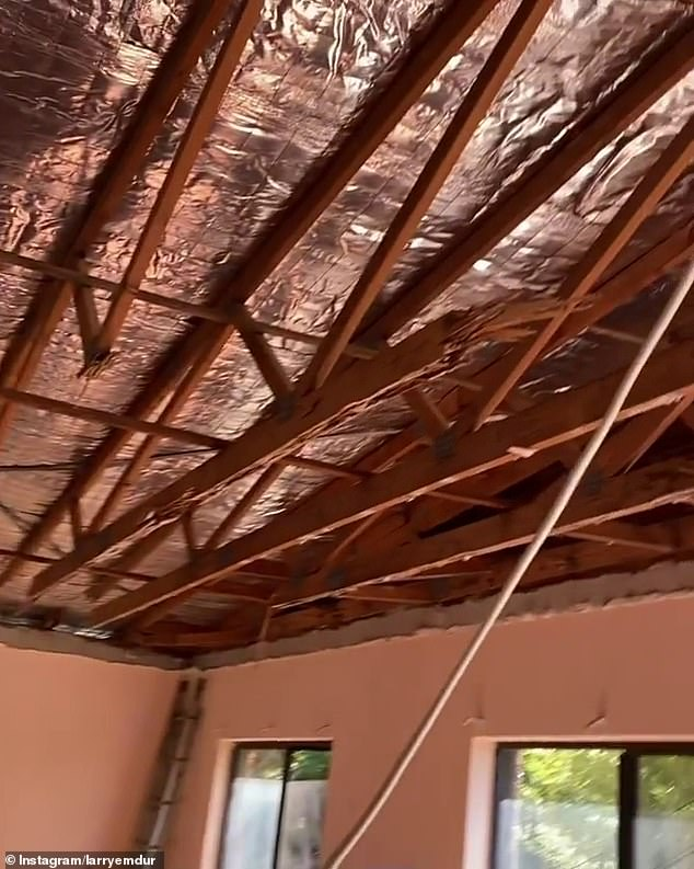 Missing parts: In the footage, Larry first shows the broken-up wooden floorboards of the property before he moves the camera towards the ceiling, which has been extracted, with only the aluminium foil insulation remaining.