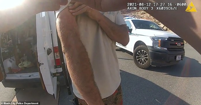 Laundriw shows cops his arms which they say note scratches on, before officers determine Petito was the 'primary aggressor'