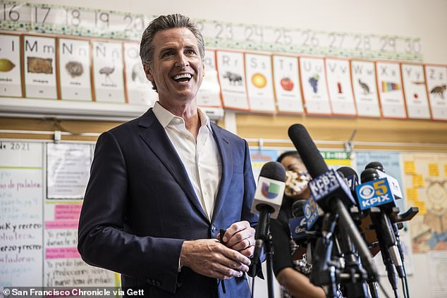 Newsom speaks to members of the media after meeting students at Melrose Leadership Academy during a school visit in Oakland, California on Wednesday, the day his recall success was declared