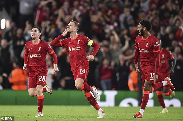 Liverpool skipper Jordan Henderson celebrates his stunning strike against AC Milan at Anfield