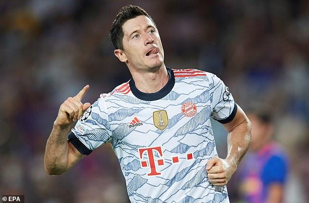 The irrepressible Robert Lewandowski celebrates one of his two goals against Barcelona