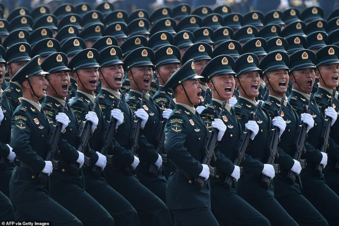 Western democratic nations are increasingly concerned at the way China is laying claim to the South China Sea, ignoring other nations territorial claims (pictured, Chinese troops marching during a military parade in Tiananmen Square in Beijing)