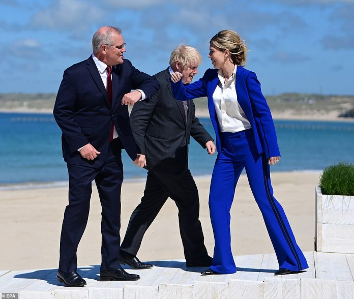 The meeting was the culmination of an 18-month plan to acquire the technology by Mr Morrison (left), who first pitched the idea to Boris Johnson (right, with wife Carrie Symonds) before arranging a three-way sit-down with Biden