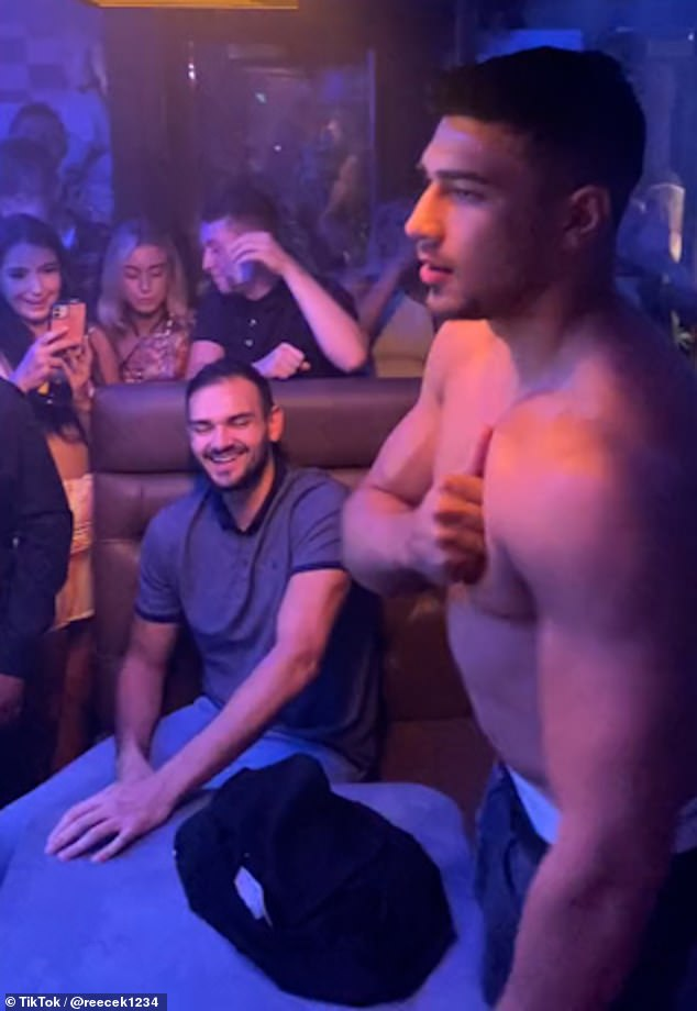 Crowd pleaser: Tommy Fury, 22, surprised onlookers as he stripped off and beat his chest while cheered on by onlookers on a night out in Liverpool