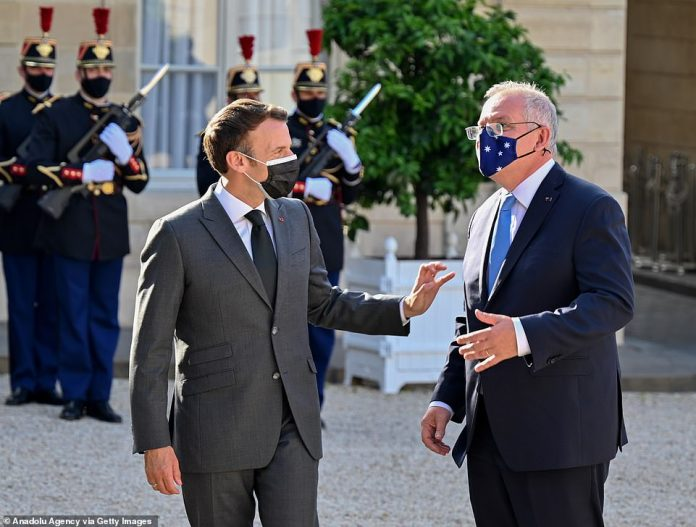 France has reacted angrily to the news, which will mean its own deal is now defunct with only $2billion received. Foreign minister Yves Le-Drian called it a 'stab in the back', likening Mr Biden's behaviour to that of his predecessor Mr Trump (pictured, Scott Morrison with Emmanuel Macron when he went to France to deliver the bad news)