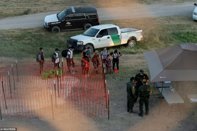 Border Patrol said in a statement it was increasing staffing in Del Rio to facilitate a 'safe, humane and orderly process'