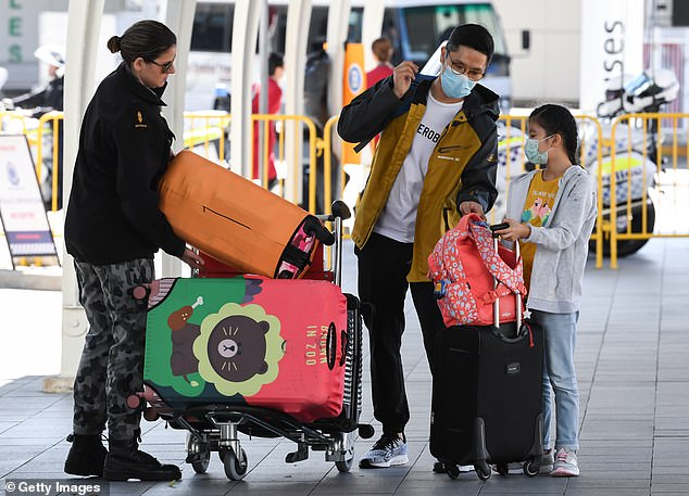 Passengers arrive at Sydney International Airport off a Cathay Pacific flight from Hong Kong on August 23. NSW is launching a four-week trial to allow 175 fully-vaccinated returned travellers to self-isolate for seven days at home
