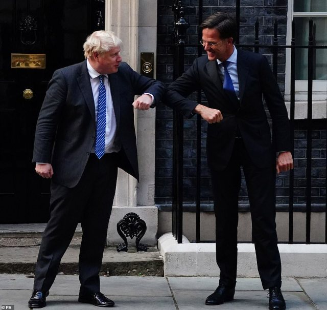 Prime Minister Boris Johnson greets Prime Minister of the Netherlands Mark Rutte, outside 10 Downing Street ahead of a bilateral meeting on Friday