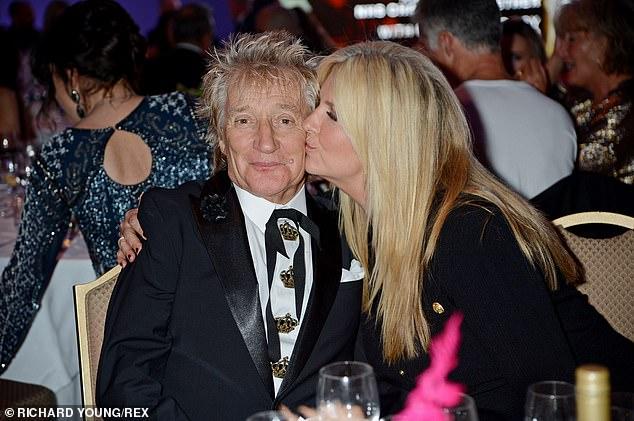 pucker up!  money a kiss on her husband's cheek